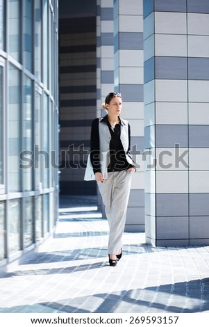 girl in the office with a folder, businesswoman - stock photo