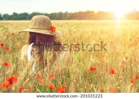 girl in the poppy field  - stock photo