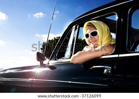 Girl in the Post-War classic car Y.O.M. 1959 - stock photo