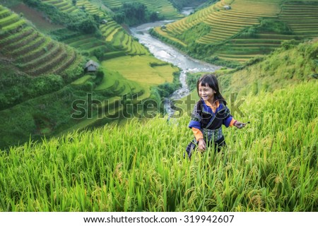 Girl in the terrace rice farm with countryside background - stock photo