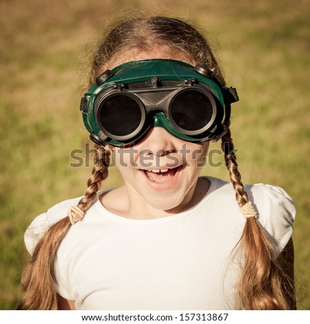 Girl in the welding goggles - stock photo