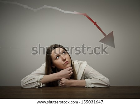 Girl in thoughts. Recession concept. - stock photo