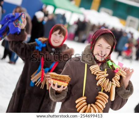 Girl  in traditional  clothes with pancake during  Maslenitsa festival - stock photo
