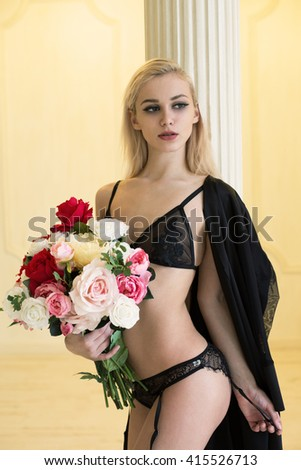 Girl in underwear with roses, studio shot  - stock photo