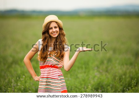 Girl in wheat field, space on image for your text or product - stock photo