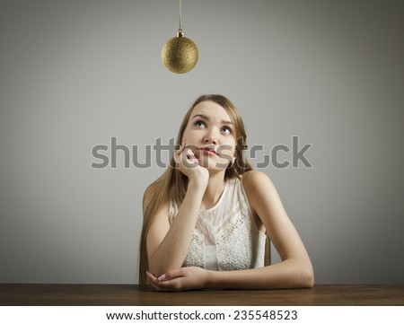 Girl in white and Christmas ball is above her head. Waiting of Christmas and New Year. - stock photo