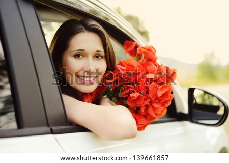 girl in white car with  poppies - stock photo