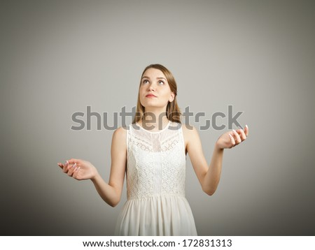 Girl in white is juggling. Concentration concept. - stock photo
