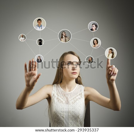Girl in white is pushing the virtual button. Communication and social network concept. - stock photo