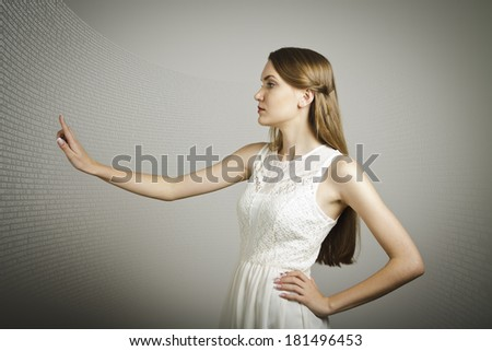 Girl in white is pushing the virtual button. Internet concept. - stock photo