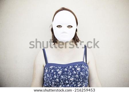 Girl in white mask on halloween, mystery - stock photo
