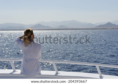 Girl in white on the yacht deck. - stock photo