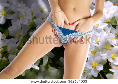 Girl in white panties. young woman body with cotton panties isolated on white background close-up.  - stock photo