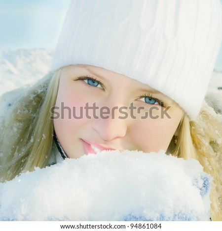 Girl in winter sunny day on white mountain landscape - stock photo