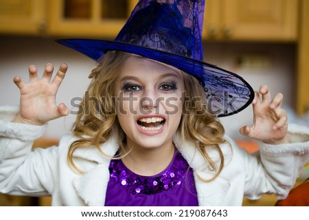 girl in  witch costume at  halloween  - stock photo