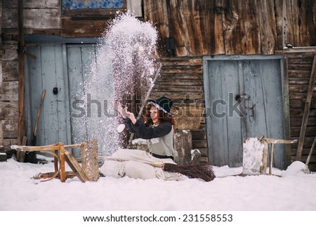 girl in witch costume fun winter day - stock photo