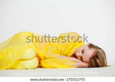 girl in yellow on the floor are sleeping - stock photo
