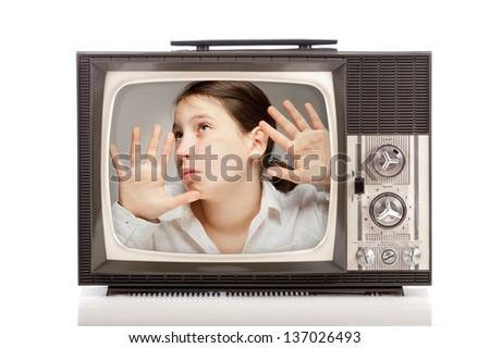 girl inside a retro portable television on white background - stock photo