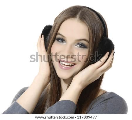 girl is a music lover, long straight hair girl in ear-phones - stock photo