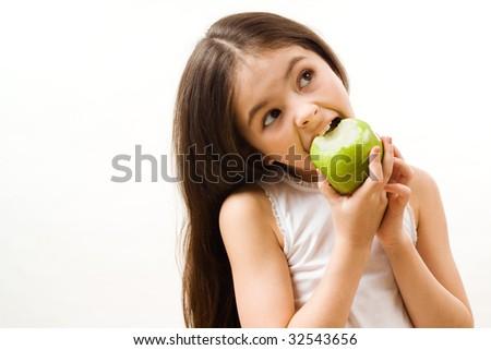 Girl is eating apple - stock photo