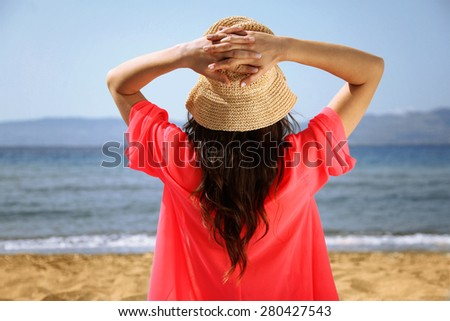Girl is Halding Her Hat and Lounge - stock photo