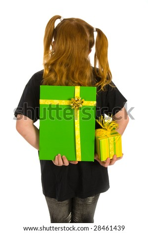 Girl is hiding green luxury presents behind her back - stock photo