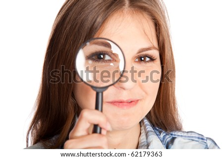 Girl is looking through magnifying glass. Isolated on white background - stock photo