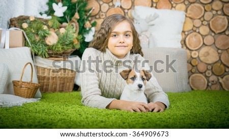 girl is lying in the floor with  dog. Girl with dog. children and pets - stock photo