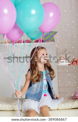 Girl is making wish with blowing candle - stock photo