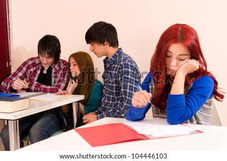Girl is not accepted by her classmates, a bullying concept - stock photo