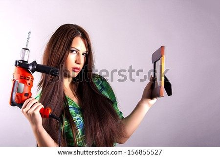 girl is posing with hammer drill - stock photo