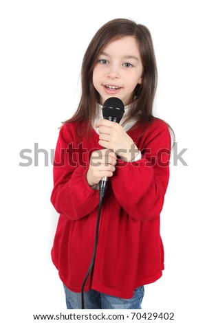Girl is singing with a microphone - stock photo