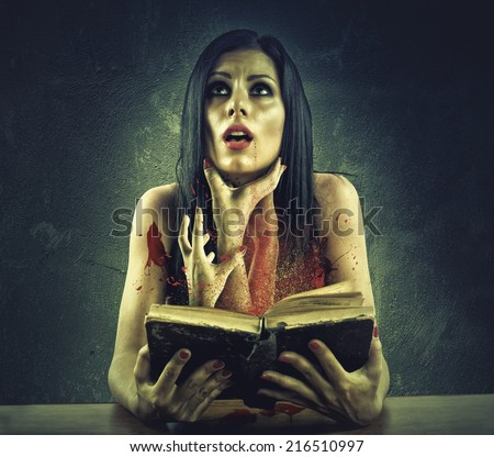 Girl is strangled by hands coming out of a horror story - stock photo