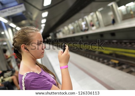 Girl is waiting train on a subway station, Athens - stock photo
