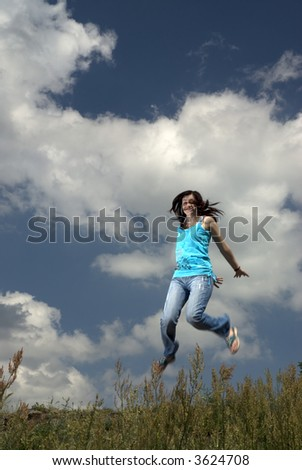 Girl jumping high in the sky - stock photo
