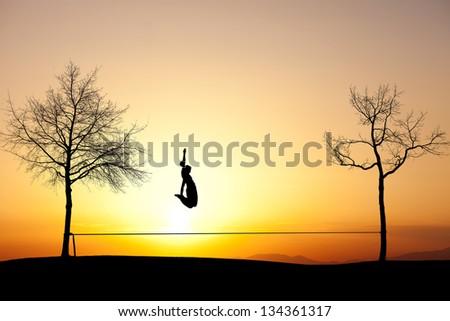 girl jumping on slackline - stock photo