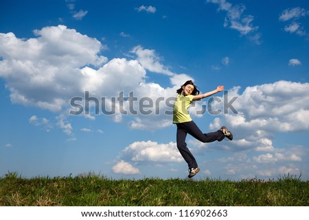 Girl jumping outdoor - stock photo