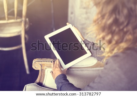 Girl keeping digital tablet, vintage photo effect - stock photo