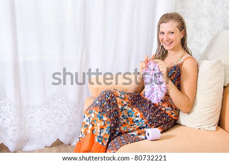 girl knits - stock photo