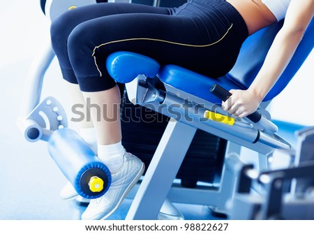 girl legs on the fitness gym - stock photo