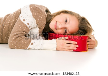 girl lies on a gift box isolated on white background - stock photo