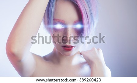 Girl like a robot with glowing eyes - stock photo