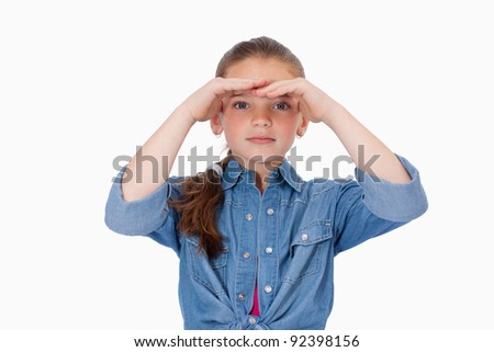 Girl looking ahead against a white background - stock photo