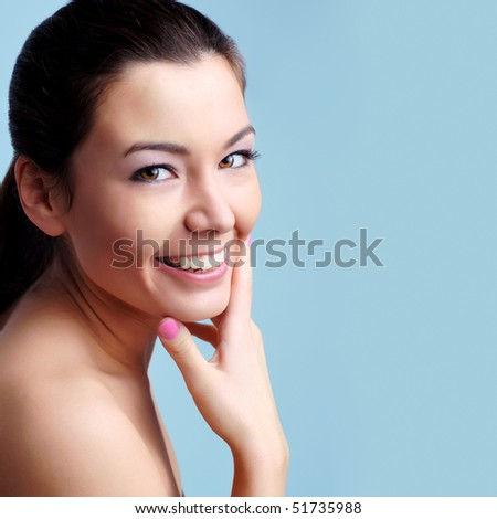 Girl looking at blank space - Close up portrait of a beautiful female model. Looking at camera - stock photo