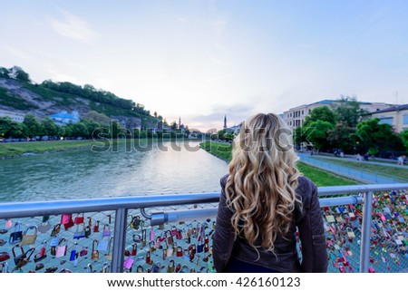 Girl looking at the Sunset in Salzburg City , Vienna Austria - stock photo