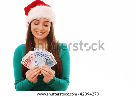 Girl looking down at Euros in santa hat on white background - stock photo