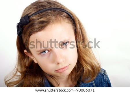 Girl looking sad against white background - stock photo