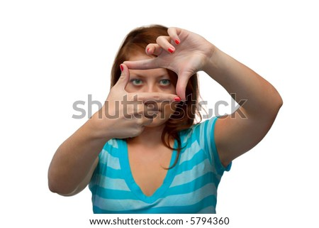 Girl looking through a frame, isolated on white background - stock photo