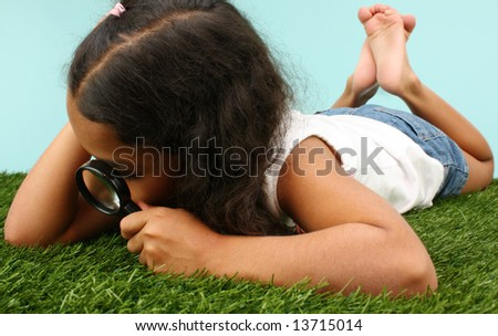 Girl Looking Through Magnifying Glass At Bugs - stock photo