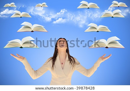 Girl looking up with flying books around her, with sky and clouds in background - stock photo